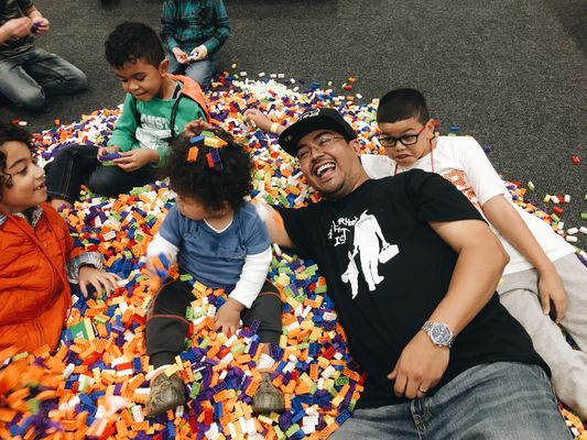 Lego Live NYC Lopez family in a pile of Lego bricks